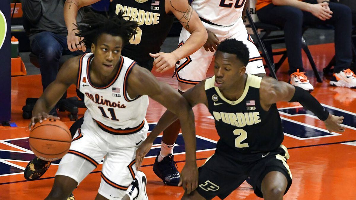 Illinois guard Ayo Dosunmu (11) powers past Purdue's guard Eric Hunter Jr. (2) in the first...