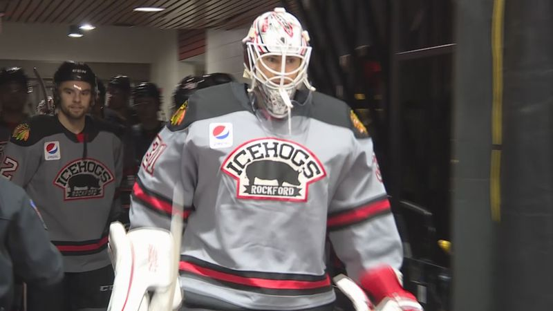 Matt Tomkins leads the Rockford IceHogs onto the ice during a regular season game on January...