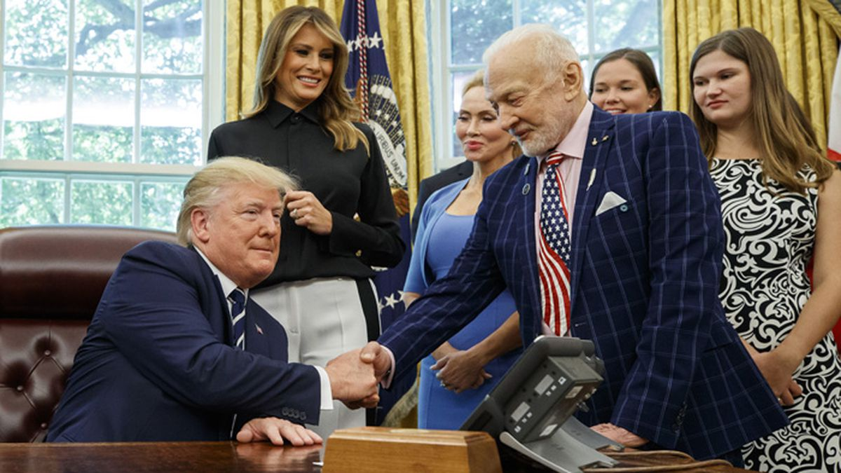 President Donald Trump shakes hands with Apollo 11 astronaut Buzz Aldrin, with first lady Melania Trump, center, during a photo opportunity commemorating the 50th anniversary of the Apollo 11 moon landing, in the Oval Office of the White House, Friday, July 19, 2019, in Washington. (AP Photo/Alex Brandon)
