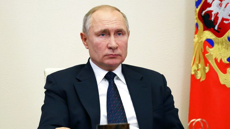 Russian President Vladimir Putin attends a meeting via video conference at the Novo-Ogaryovo...