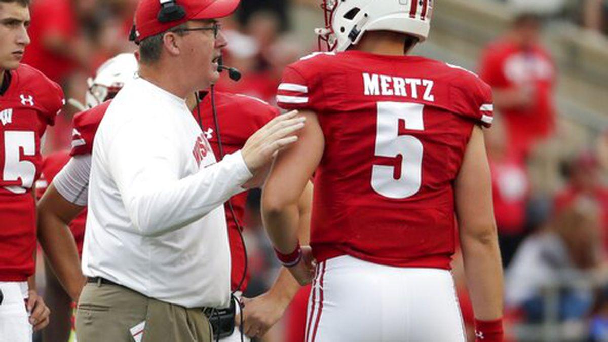 Wisconsin head coach Paul Chryst talks to quarterback Graham Mertz during the second half of an...
