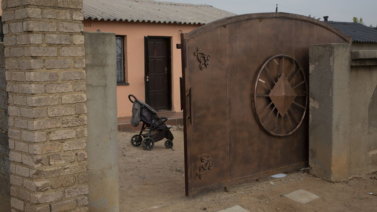 A pram stands outside the home of Gosiame Thamara Sithole in Tembisa, near Johannesburg,...