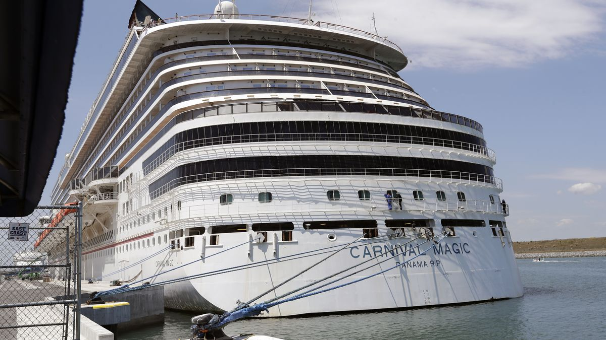 FILE - In this Saturday, April 4, 2020, file photo, Carnival cruise line ship Carnival Magic is...