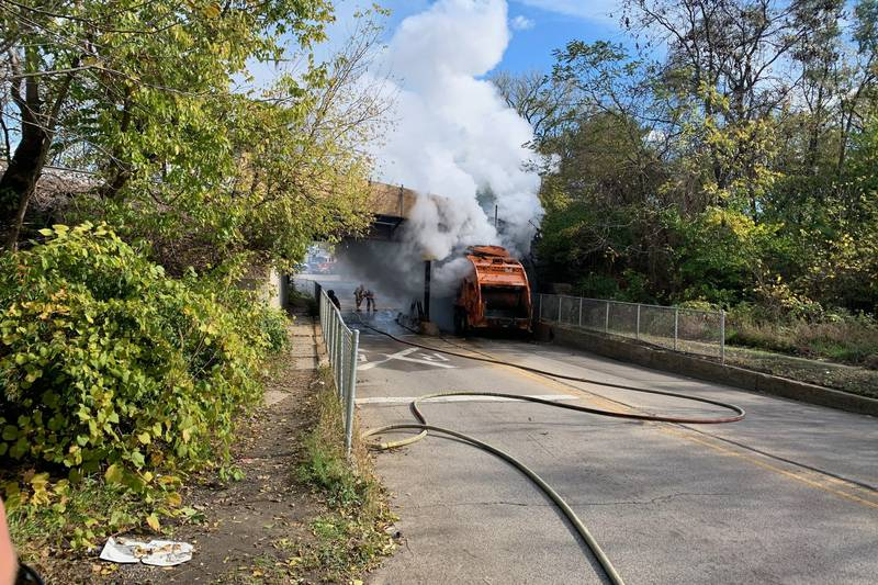 A garbage truck catches fire under a train track bridge near 15th and Broadway in Rockford.