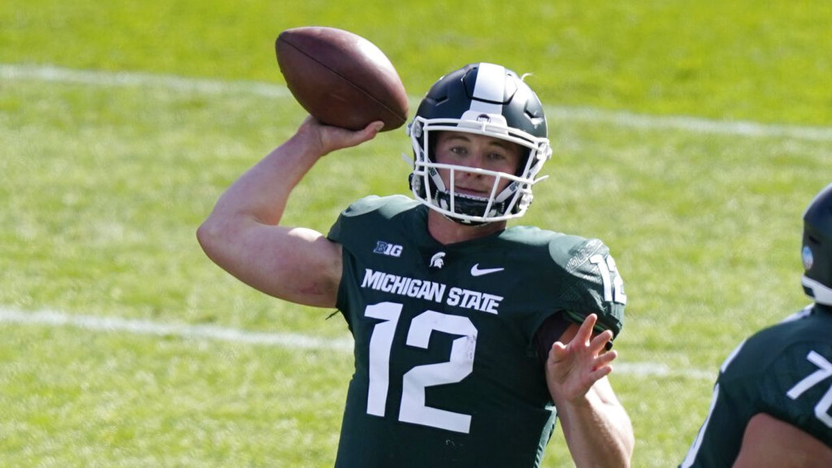Michigan State quarterback Rocky Lombardi throws during the first half of an NCAA college...