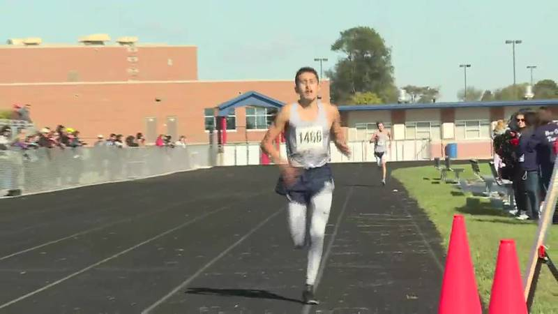Guilford's Juan Del Real wins the boys' race at the NIC-10 conference meet at Belvidere North...