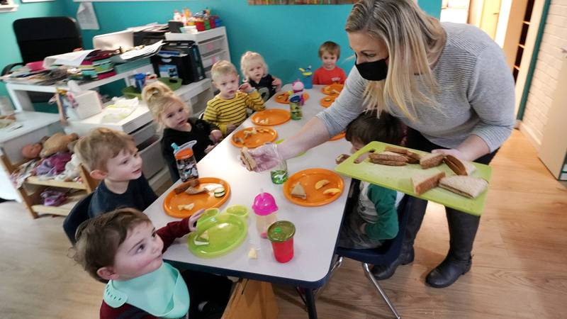 Amy McCoy serves lunch to preschoolers at her Forever Young Daycare facility, Monday, Oct. 25,...