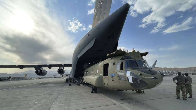 In this image provided by the Department of Defense, a CH-47 Chinook from the 82nd Combat...