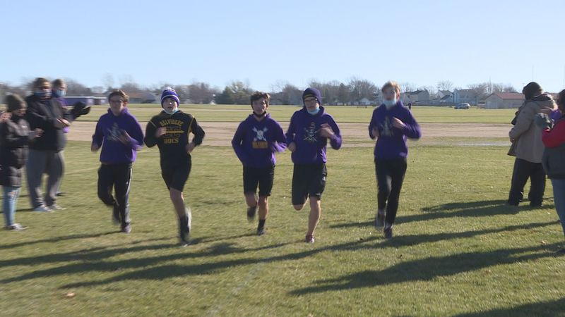 The Bucs boys cross country team completes the three mile course at Belvidere High School on...