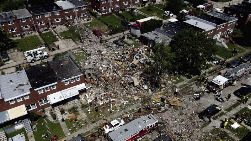 Debris and rubble covers the ground in the aftermath of an explosion in Baltimore on Monday,...