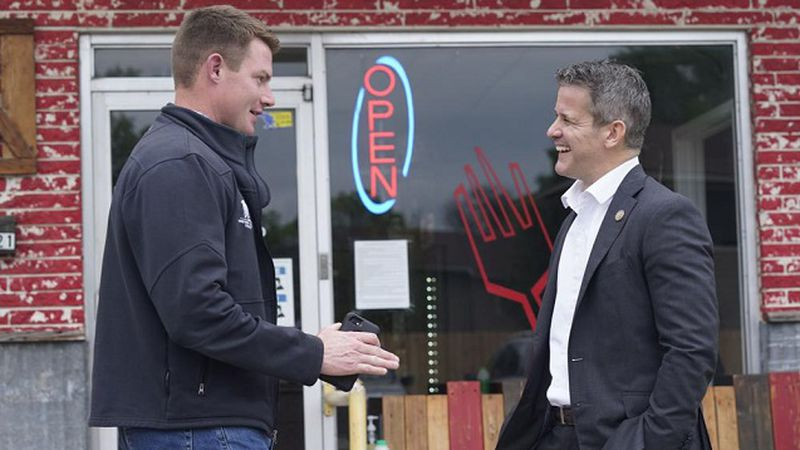 Rep. Adam Kinzinger, R-Ill., right, chats with Texas congressional candidate Michael Wood...