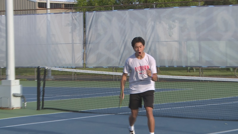 Auburn's Chris Park pumps his fist in celebration after winning a point during the 1 Singles...