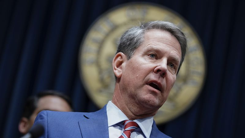 In this Dec. 4, 2019, file photo, Georgia Gov. Brian Kemp takes questions from the media at the...