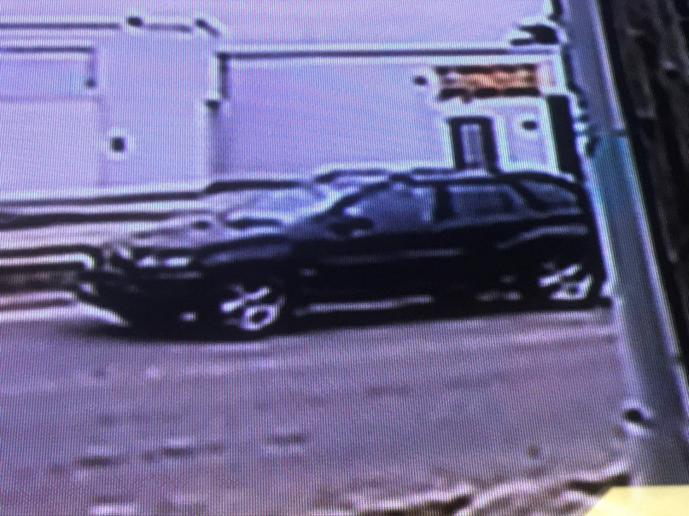 The suspect car is described as a black BMW SUV.