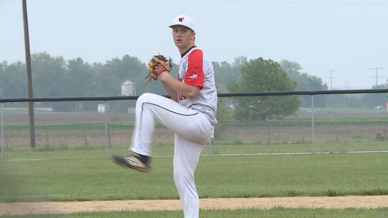 Winnebago's Cole Schrank winds up to throw a pitch against Dixon on a rainy Friday afternoon at...