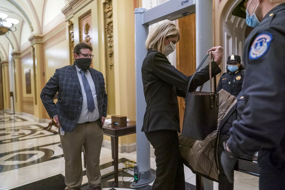 Metal detectors are set up for lawmakers and staff before entering the House chamber, a new...