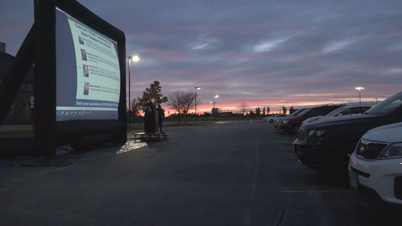 Rock Valley College curbside event mimics drive-in theater.