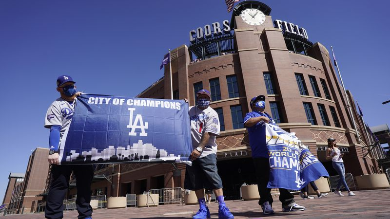Los Angeles Dodgers fans Oliver Olson, left, of San Diego, Juan Campo and Rudy Soto, both of...