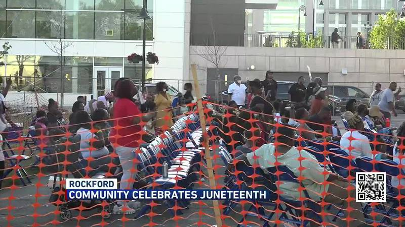 MEMBERS OF THE COMMUNITY CELEBRATE A NEW HOLIDAY SIGNED INTO STATE LAW.
