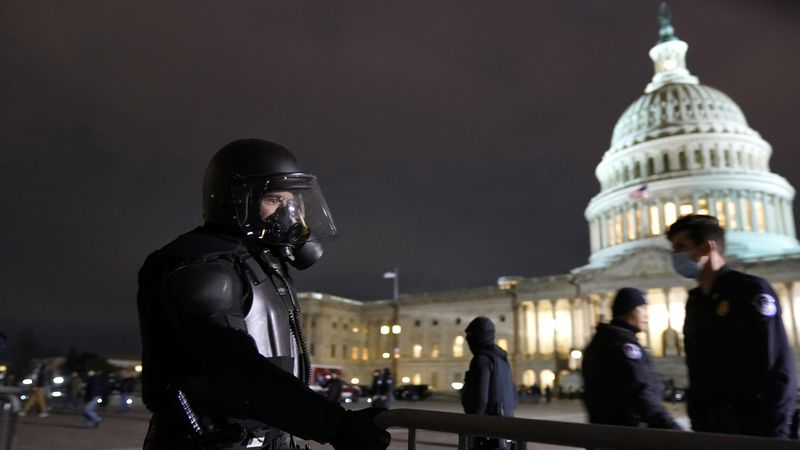 Authorities secure the area outside the U.S. Capitol, Wednesday, Jan. 6, 2021, in Washington.