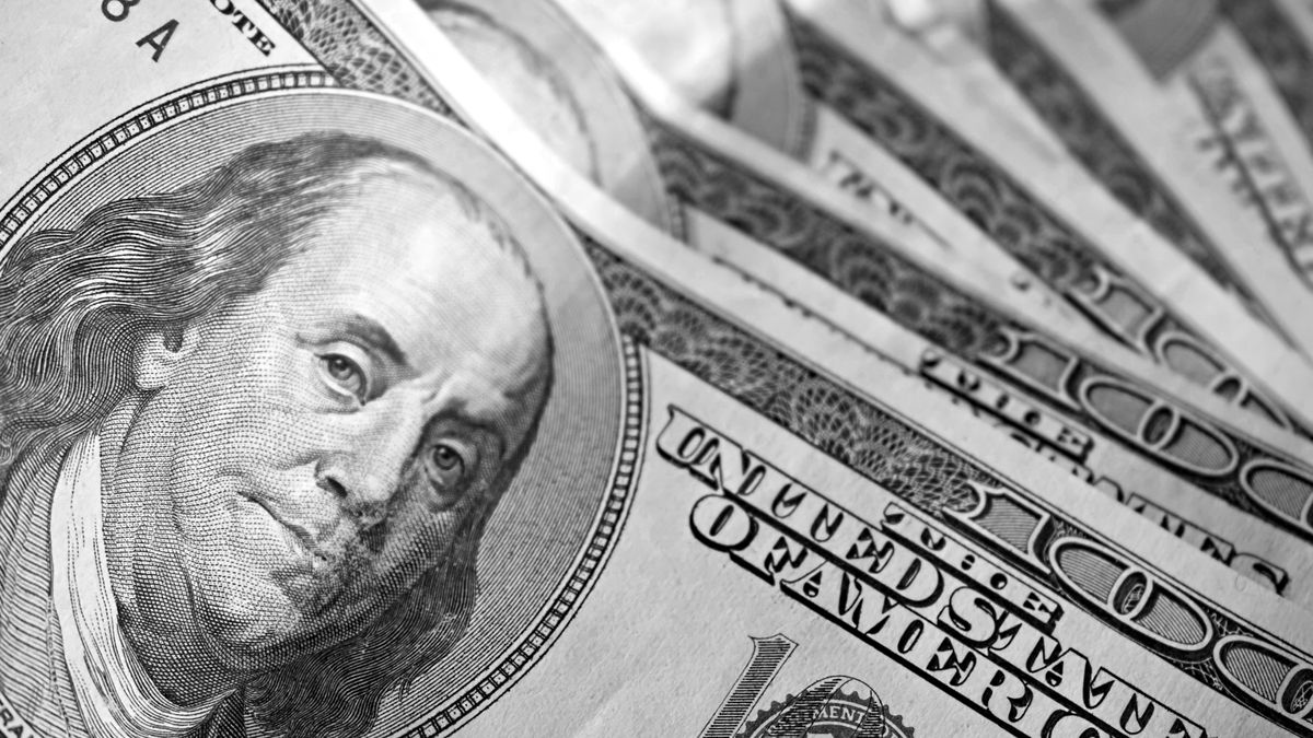 A close-up of the new 100 dollar bill picturing Benjamin Franklin. It's all about the Benjamin's.