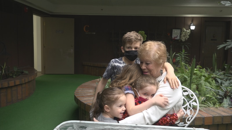 Rose Gagnon embraces her great-grandchildren after receiving her second dose of the Pfizer...