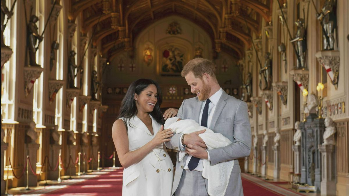 SOURCE (AP): Britain's Prince Harry and Meghan, Duchess of Sussex, during a photocall with their newborn son, in St George's Hall at Windsor Castle, Windsor, south England, Wednesday May 8, 2019.