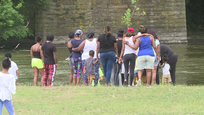 Madison Billups' family gathers by the river. The 9-year-old's body was recovered after more...