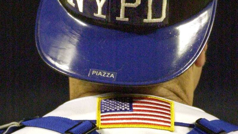 FILE - In this Sept. 21, 2001, file photo, New York Mets catcher Mike Piazza wears the NYPD...
