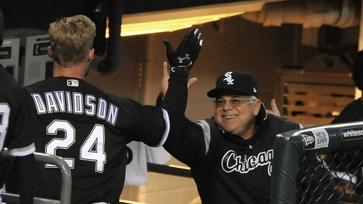 Chicago White Sox's Matt Davidson (24) celebrates with manager Rick Renteria right, in the dugout after hitting a solo home run during the second inning of a baseball game against the Kansas City Royals, Monday, April 24, 2017, in Chicago. (AP Photo/Paul Beaty)