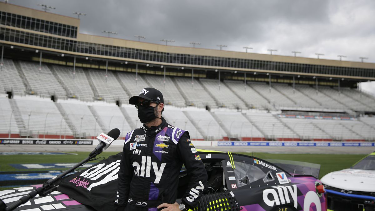 Jimmie Johnson is interviewed before a NASCAR Cup Series auto race at Atlanta Motor Speedway, Sunday, June 7, 2020, in Hampton, Ga. (AP Photo/Brynn Anderson)