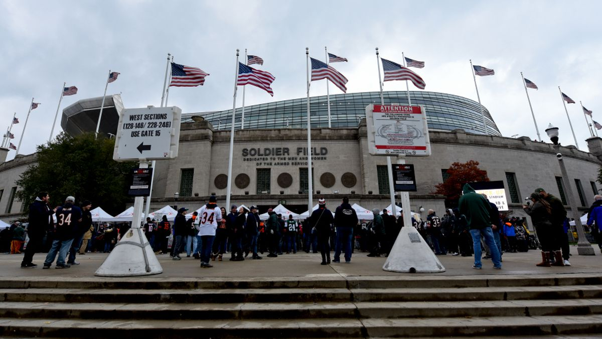 Fans enter Soldier Field before an NFL football game between the New York Jets and the Chicago Bears Sunday, Oct. 28, 2018, in Chicago. (AP Photo/Matt Marton)