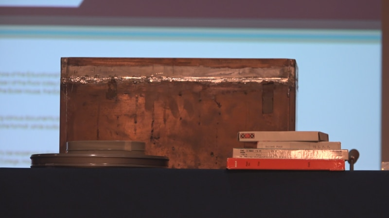School officials remove the cornerstone, and open the case filled with items from 50 years ago.