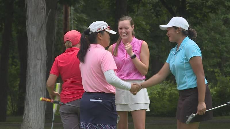Hui Chong Dofflemyer (left) shakes Megan Thiravong's hand (right) after winning the women's...