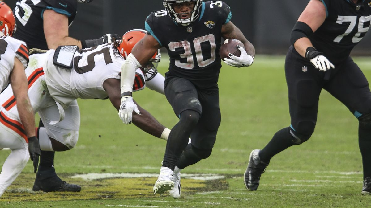 Jacksonville Jaguars running back James Robinson (30) runs for a first down during the second...