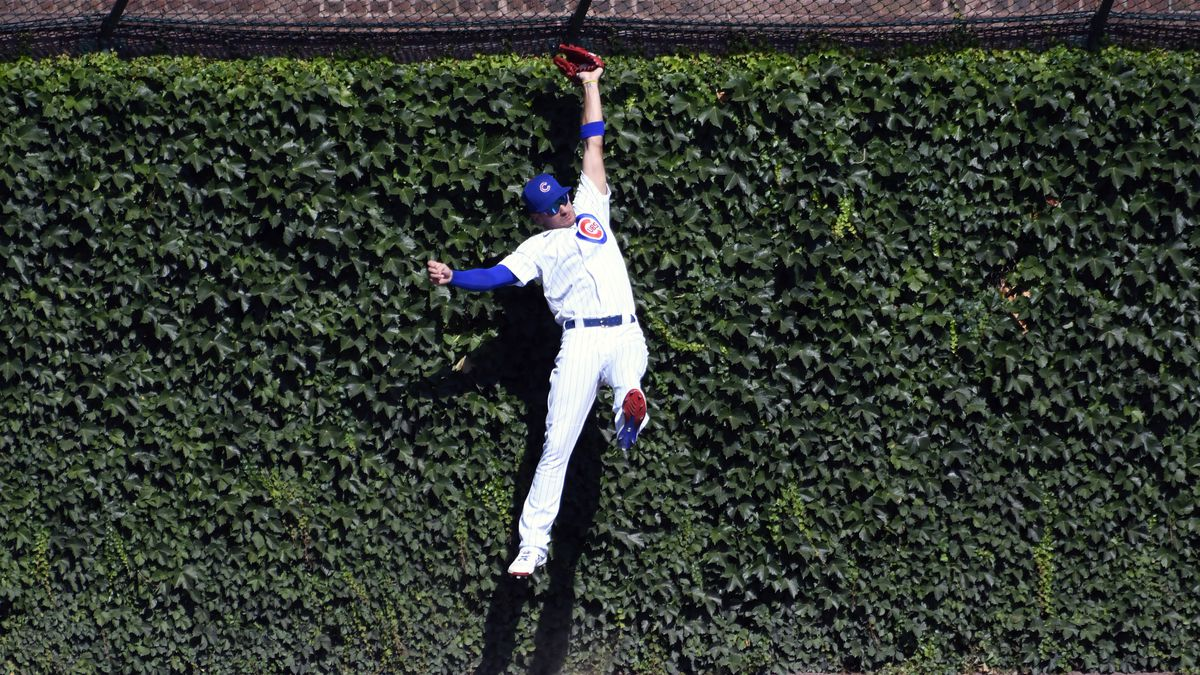 Chicago Cubs center fielder Albert Almora Jr. (5) makes a catch against Milwaukee Brewers' Logan Morrison during the ninth inning of a baseball game, Sunday, July, 26, 2020, in Chicago. (AP Photo/David Banks)