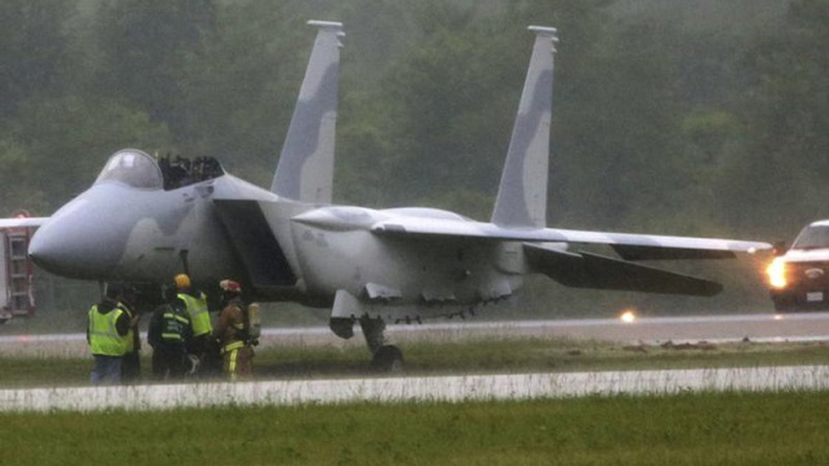 Emergency crews on the scene where two pilots ejected from a F-15 fighter aircraft on a runway...