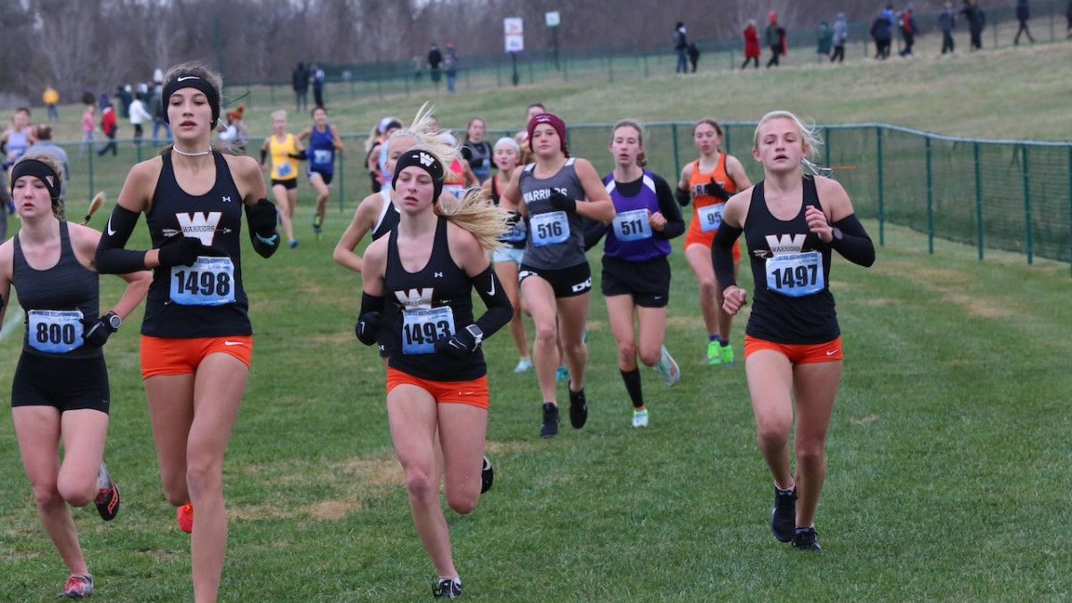 Pictured from left to right: Kaylee Woolery, Katie Erb, and Marissa Roggensack run side-by-side...