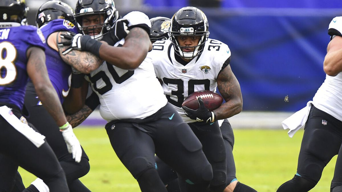 Jacksonville Jaguars running back James Robinson (30) runs the ball during the second half of...