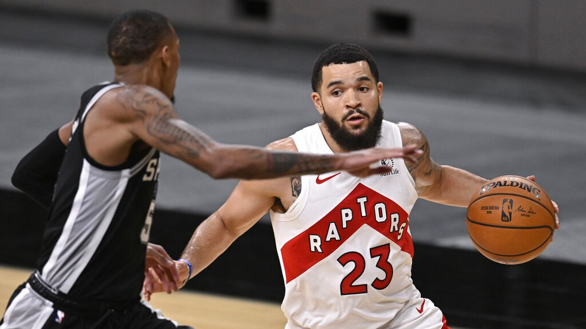 Toronto Raptors' Fred VanVleet (23) drives around San Antonio Spurs' Dejounte Murray during the...