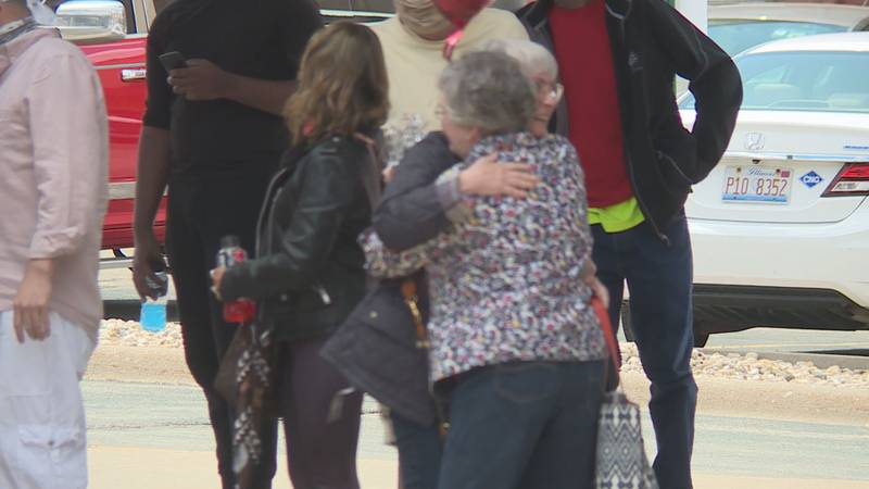 Bonnie Weaver hugs half sister Dale Austein in first ever meeting between the two.