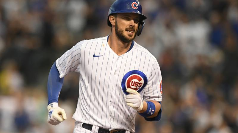 Chicago Cubs' Kris Bryant rounds the bases after hitting a solo home run during the fourth...