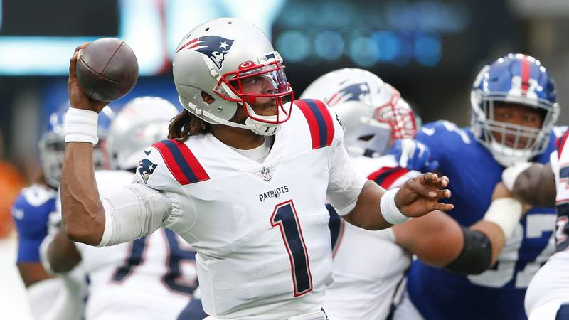 New England Patriots quarterback Cam Newton (1) throws a pass during the first half of an NFL...