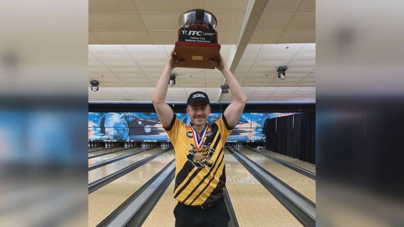 Hononegah grad Nick Sommer lifts the ITC Helmer Cup after helping Wichita State win the...