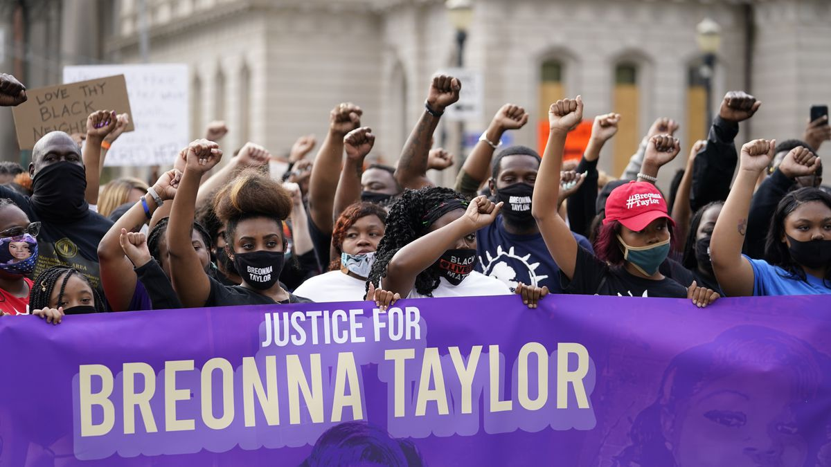 In this Sept. 25, 2020, file photo, Black Lives Matter protesters march in Louisville. Hours of...