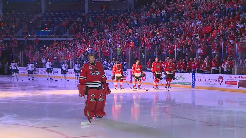 IceHogs goalie Collin Delia stands on the ice during the playing of the Canadian National...