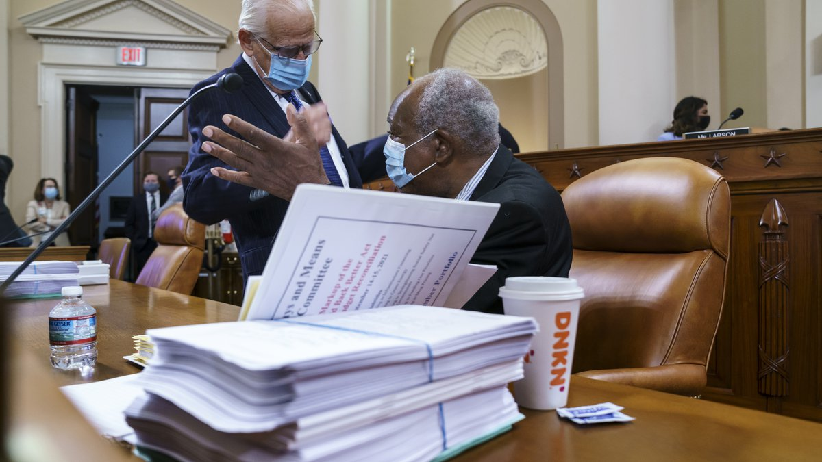 Rep. Bill Pascrell, D-N.J., left, and Rep. Danny Davis, D-Ill., confer as the tax-writing House...