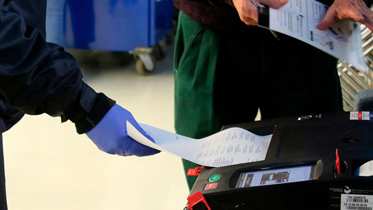In this Saturday, March 14, 2020 photo, voters cast their ballots during early voting in...