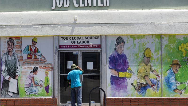 FILE - In this May 7, 2020, file photo, a person looks inside the closed doors of the Pasadena...