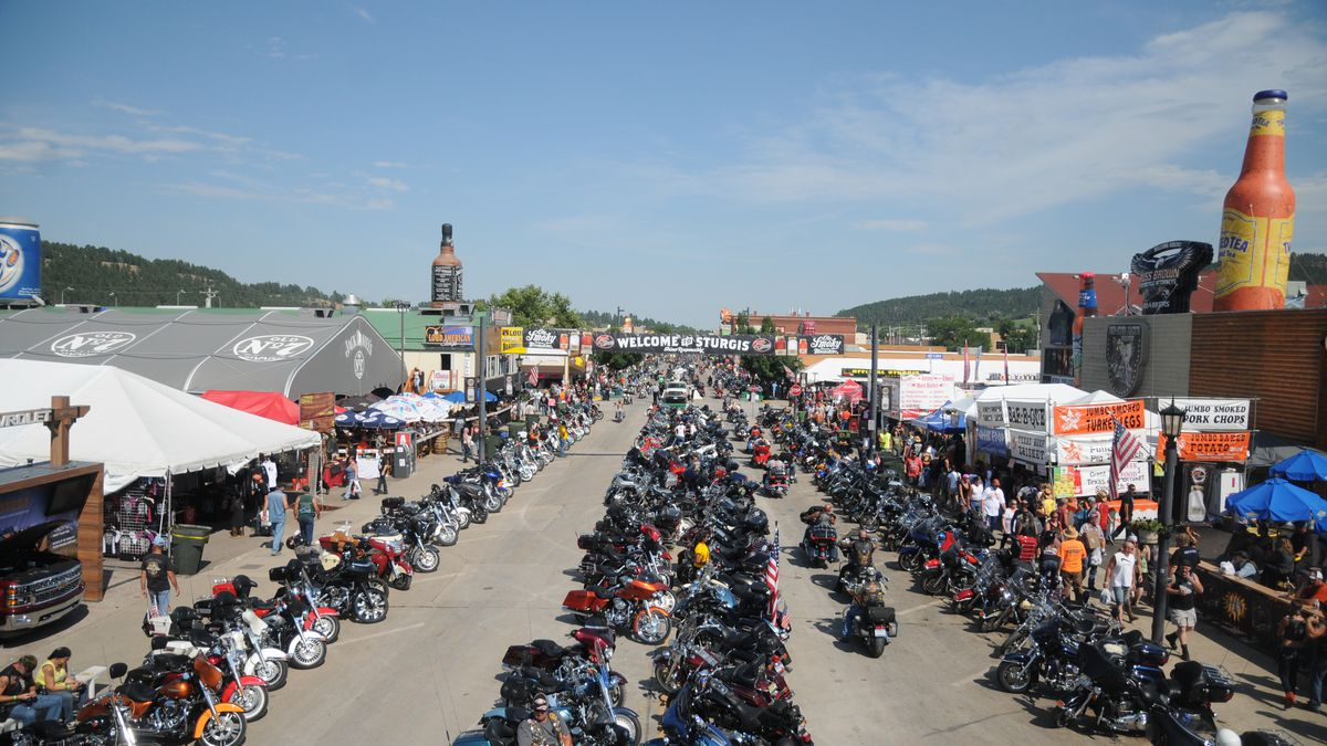 Motorcycles stretch down Main Street in Sturgis, S.D., on Wednesday, Aug. 5, 2015, for the landmark 75th Sturgis Motorcycle Rally. (AP Photo/James Nord)